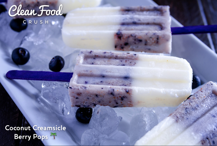 Homemade Coconut Creamsicle Berry Pops http://cleanfoodcrush.com/coconut-creamsicle-pops/