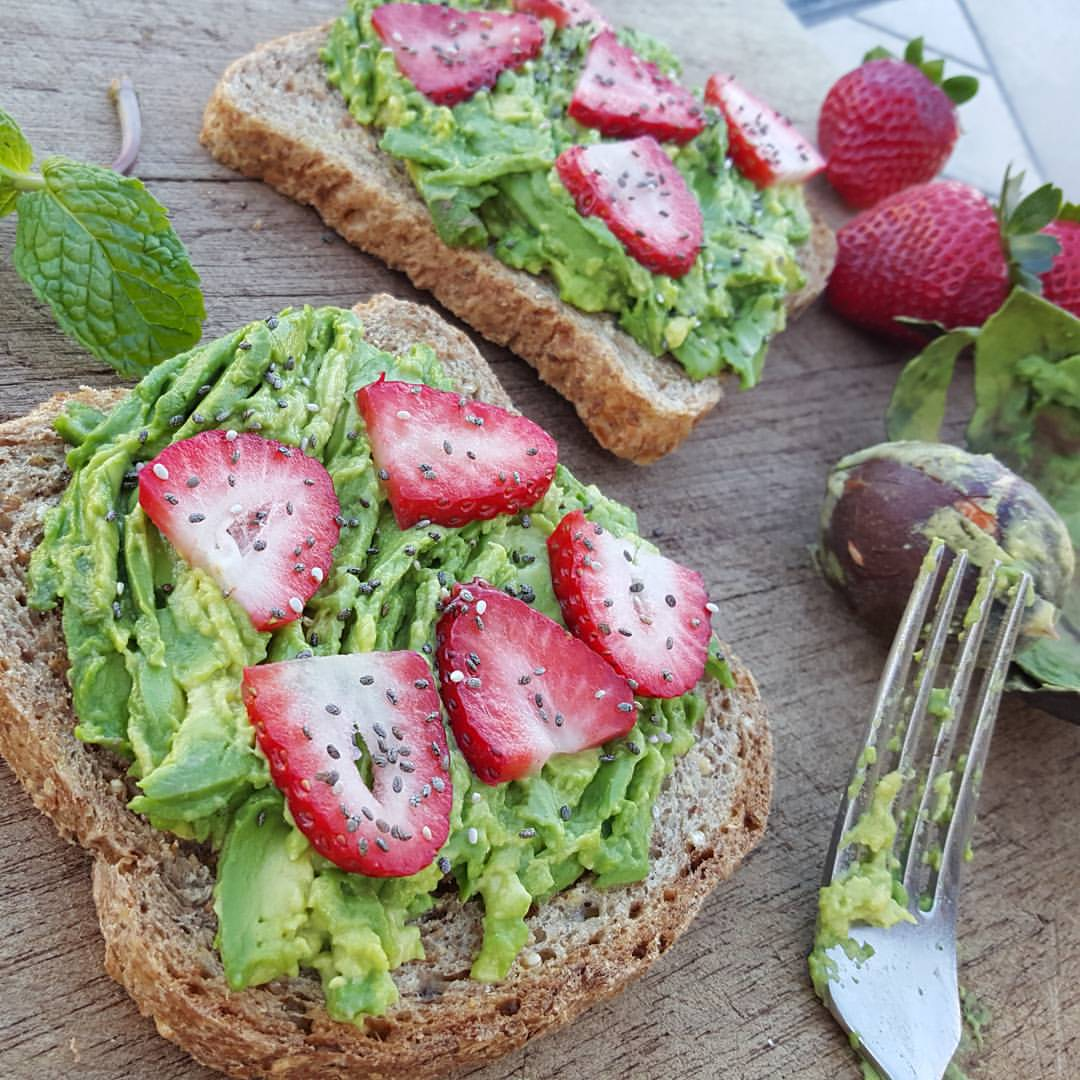 Grinch Toast – Ezekiel Bread with Avocado, Strawberries, & Chia Seeds