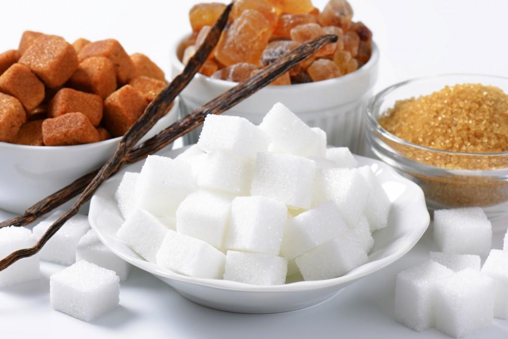 Still life of various types of sugar in bowls