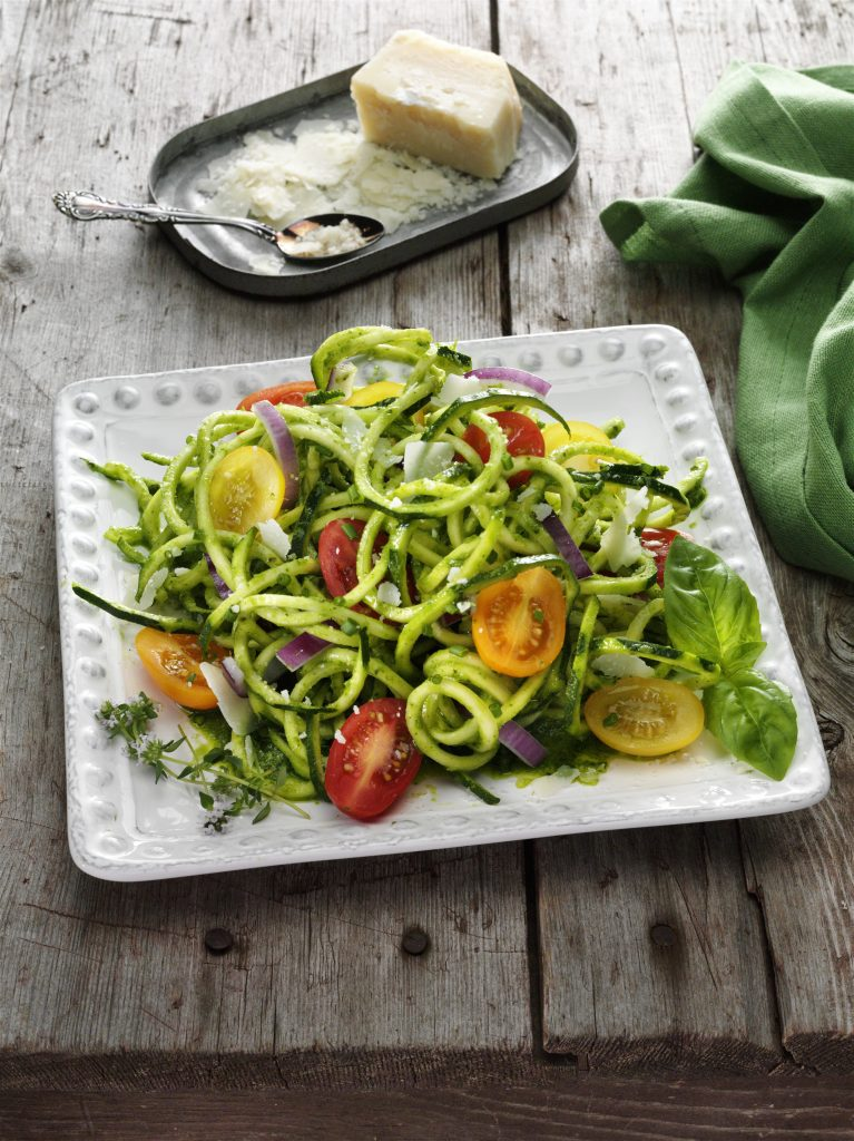 Spiral courgette noodles and tomatoes with chimichurri and Parmesan cheese