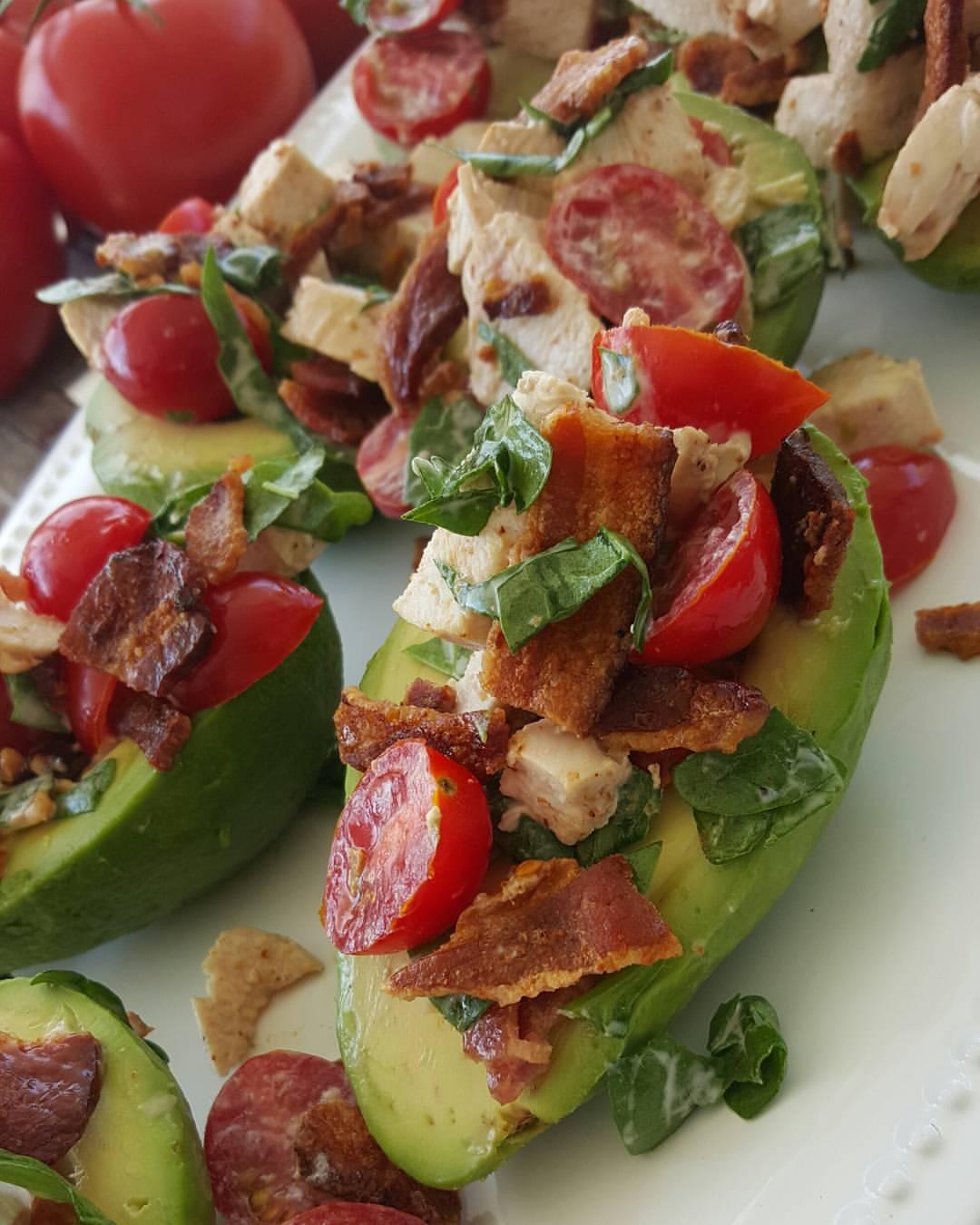 BLT Stuffed Avocado Recipe https://cleanfoodcrush.com/blt-avocados/