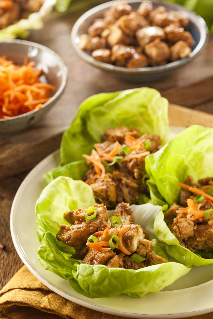 Healthy Asian Chicken Lettuce Wrap with Carrots https://cleanfoodcrush.com/honey-sesame-chicken-lettuce-wraps/