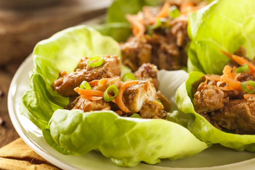 Healthy Asian Chicken Lettuce Wrap https://cleanfoodcrush.com/honey-sesame-chicken-lettuce-wraps/