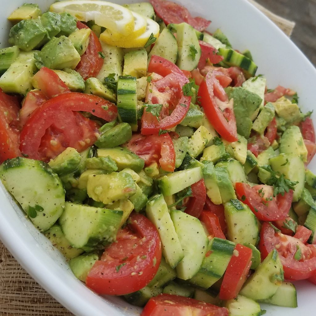 Summer Tomato Avocado Salad w/ our favorite homemade Greek dressing.
