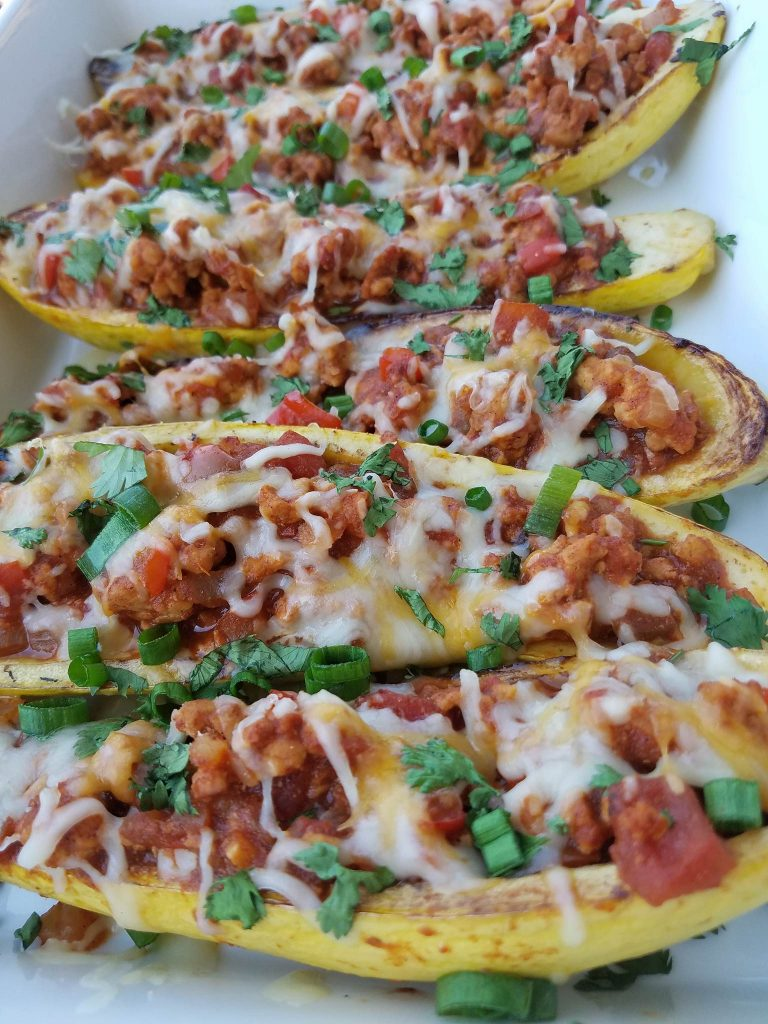 Clean Eating Taco Stuffed Summer Squash Boats https://cleanfoodcrush.com/taco-stuffed-squash/