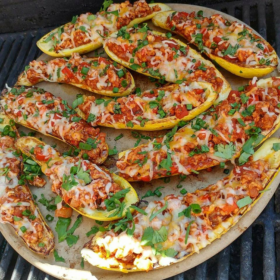 Taco Stuffed Summer Squash Boats Recipe https://cleanfoodcrush.com/taco-stuffed-squash/