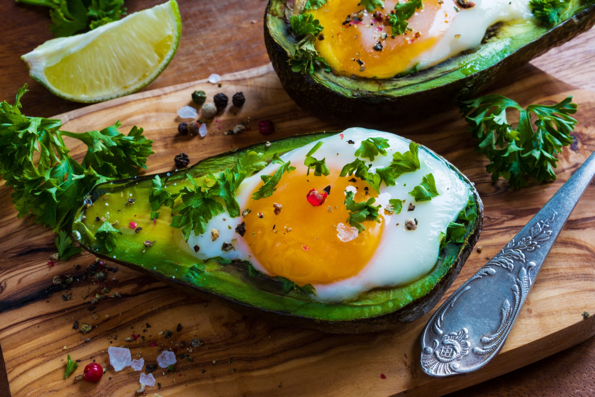 Avocado topped with egg and spring onions