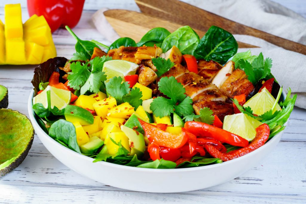 Sweet and sour chicken salad with mango