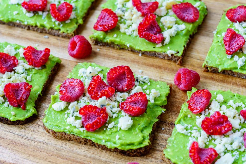 Cheesy avocado and berry toast recipe