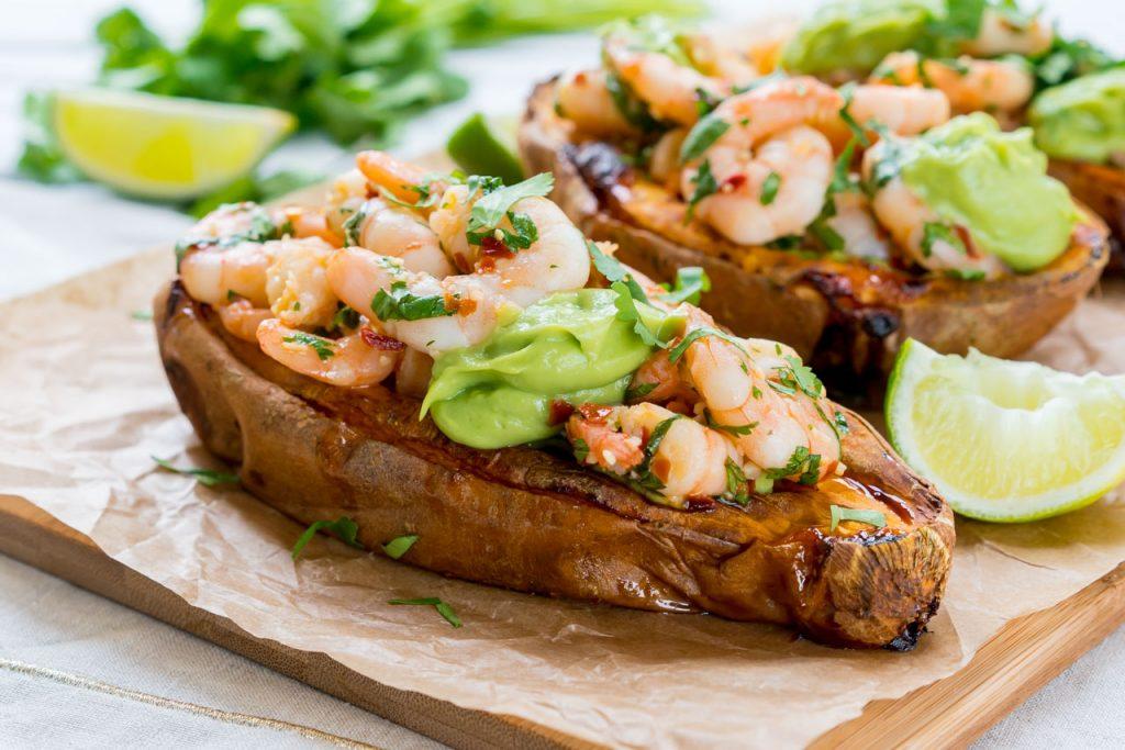 Spicy Shrimp Stuffed Sweet Potatoes + Avocado Cream CleanFoodCrush