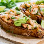 Spicy Shrimp Stuffed Sweet Potatoes + Avocado Cream CleanFoodCrush