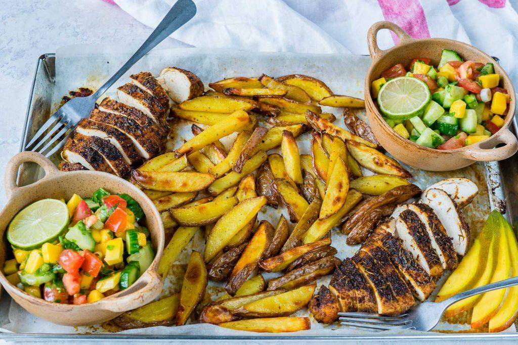 Clean Eating Sheet Pan Jerk Chicken with Baked Fries + Fresh Mango Salsa