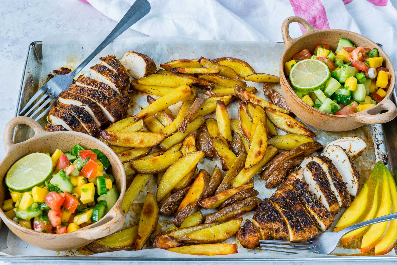 Clean Eating Sheet Pan Jerk Chicken with Baked Fries + Fresh Mango Salsa