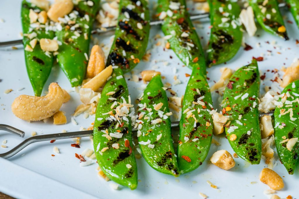 Grilled Peas Sprinkled with Toasted Coconut Cashews