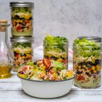 Fiesta Taco Salad-in-a-jar with Creamy Avocado + Cilantro Dressing by CleanFoodCrush