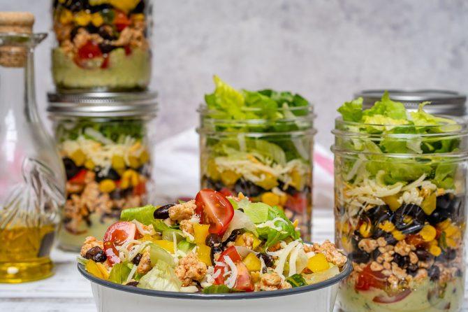 Fiesta Taco Salad-in-a-jar with Creamy Avocado + Cilantro Dressing by CleanFoodCrush